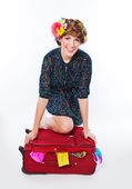 Young woman packing her suitcase — Stock Photo
