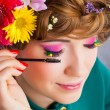 Woman with make-up applies ink brush on eyelashes — Stock Photo #25366655