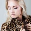Beautiful fashionable girl in fur coat — Stock Photo