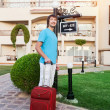 Man arriving at Hotel with his luggage — Stock Photo #25954707