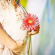 Stock Photo: Pregnant womholding her belly and flower