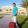 Man arriving at Hotel with his luggage — Stock Photo #25964253