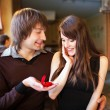 Stock Photo: Mproposing to his girlfriend in restaurant