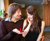 Man proposing to his girlfriend in a restaurant — Stock Photo