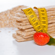 Diet flakes, measuring tape and strawberry — Stock Photo