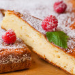 Fresh fruit tart covered in raspberries — Stockfoto