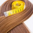 Stock Photo: Hair with measuring tape