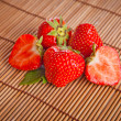 Fresh red strawberries on wooden table — Stock Photo