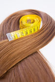 Hair with a measuring tape — Stock Photo