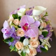 Stock Photo: Wedding bouquet of roses and orchid