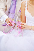 Bride and groom with glasses of champagne wine — Stock Photo
