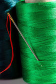 Macro green spool of thread with needle — Stock Photo