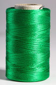 Macro green spool of thread — Stock Photo