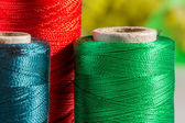 Macro green, red, blue spools of thread — Zdjęcie stockowe