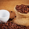 Coffee cup and coffee beans — Stock Photo
