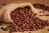 Sack bag full of roasted coffee beans — Stock Photo
