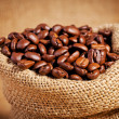 Sack bag full of roasted coffee beans — Stock Photo #36883101