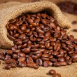 Sack bag full of roasted coffee beans — Stock Photo #36883179