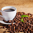 Stock Photo: Coffee cup and arabicbeans on cloth sack