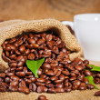 Sack bag full of roasted coffee beans — Stock Photo #36883269