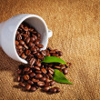 Coffee cup and arabica beans on cloth sack — Stock Photo