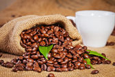 Sack bag full of roasted coffee beans — Stock Photo