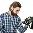 The man with beard watching at a gas mask — Stock Photo #43013623