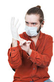 The young man dressing a medical rubber glove — Stock Photo