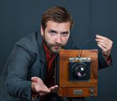 Photographer with an old camera — Stock Photo