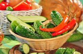 Cucumbers and red peppers — Stock Photo