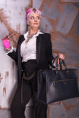 Woman in suit and turban with bag — Stock Photo