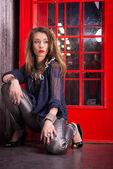 Fashionable woman near call-box — Foto Stock