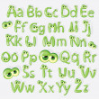 Cartoon green alphabet with eyes — Stock Vector