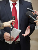 Business meeting conference journalism microphones — Stockfoto