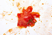 Splattered splashed tomato vegetable food — Stock Photo