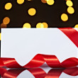 Greeting card with ribbon note christmas lights — Stock Photo