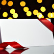 Greeting card with ribbon note christmas lights — ストック写真