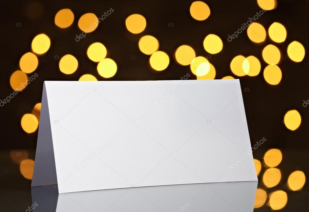 Close up of  card note on bright blurred lights background — Stock Photo #13767805