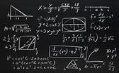 Close up of math formulas on a blackboard — Stock Photo