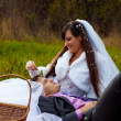 Bride and groom picnic yellow autumn forest in romantic setting, — Stock Photo #14552373