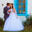 Pair is old building with window bars, newlyweds couple man and — Stockfoto