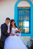 Pair is old building with window bars, newlyweds couple man and — Stock Photo
