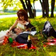 Redhead bride and groom, wedding in a green field, a picnic on g — Stock Photo #15314179