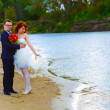Newly married couple are on the beach at the river, the bride an — Stock Photo