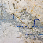 Wall with cracks texture fissure damages paint — Stock Photo