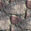 Royalty-Free Stock Photo: Red granite seamless texture to the edges of wallpaper