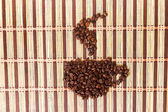 Symbol texture of coffee grains on the mat — Stock Photo