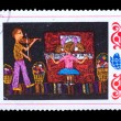 BULGARIA - CIRCA 1982: A stamp printed in BULGARIA, girl plays p - Stockfoto