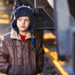 Stock Photo: Boy homeless bum on street freezing close to railway carriage in