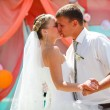 Stock Photo: Couple bride and groom kissing on wedding day dance